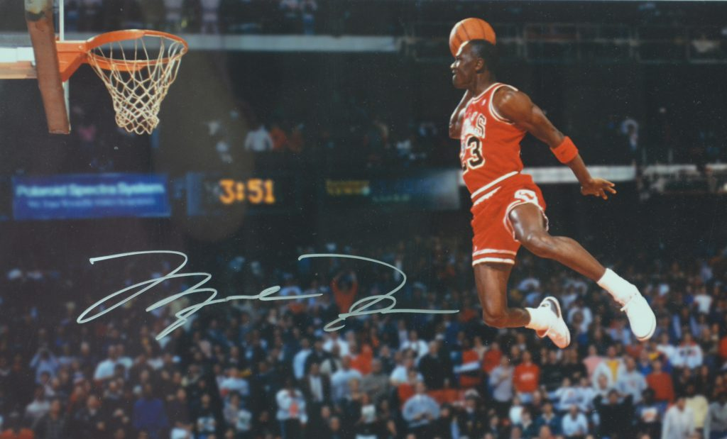 fa6cfefc00a2 Autographed image of Michael Jordan dunking from the free throw line during  the 1988 Gatorade Slam Dunk Contest